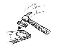 锤子和钉子乱画 免版税库存照片