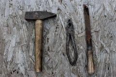 锤子钳子和粗锉 库存照片