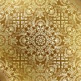 锦缎金黄无缝的墙纸 库存图片