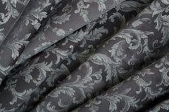 锦缎,波浪黑挂毯纹理背景 库存图片