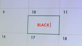 键入在网上日历的人黑星期五,折扣提示,购物的时间 股票视频