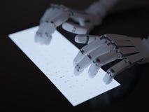 键入在萤光键盘的机器人 免版税库存照片