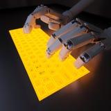 键入在萤光键盘的机器人 库存照片