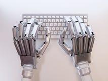 键入在键盘的机器人 免版税图库摄影