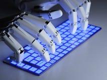 键入在键盘的机器人 图库摄影