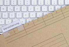 键盘和文件夹保险 免版税库存图片