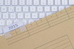 键盘和文件夹2015年 免版税库存图片