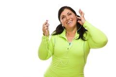 锻炼衣裳的西班牙妇女,音乐播放器 免版税库存照片