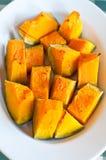 镀烤在烤箱和被晒干的南瓜与的橄榄油 图库摄影