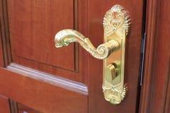 镀金的门把 免版税库存图片
