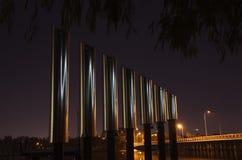 镀铬物管在晚上 库存照片