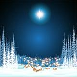 镇在冬天夜圣诞节背景中 免版税库存图片
