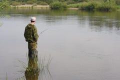 镇静渔夫捕鱼河 库存照片
