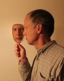 镜子的人 免版税库存图片