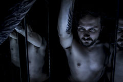 镜子,男性模型,罪恶,窗帘,死亡下落的天使  图库摄影