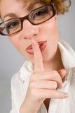 镜片手指近女孩嘴唇 库存照片