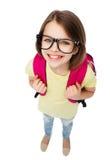 镜片的愉快的微笑的十几岁的女孩有袋子的 库存照片