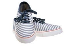 镶边在白色的易穿脱的衣服便鞋 免版税库存图片