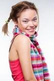 镶边的女孩俏丽的围巾面带笑容 库存照片