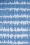 镶边领带洗染了在棉织物的样式背景的 免版税库存图片