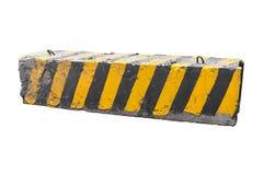 镶边黑和黄色混凝土路障碍 免版税库存照片
