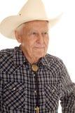年长人牛仔仔细的审视边 免版税图库摄影