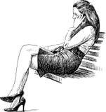 长凳的女孩 库存图片