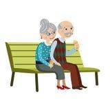 长凳的祖父母 库存照片