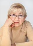 年长妇女画象戴眼镜的 免版税库存照片