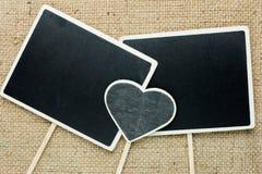 长方形标志的黑板和心脏 库存图片