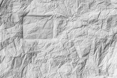 长方形的剪影在白色的弄皱了纸 免版税库存图片