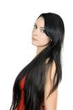 长期美丽的深色的头发 免版税库存照片