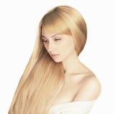 长期美丽的白肤金发的女孩头发 图库摄影
