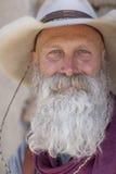 长期胡子牛仔白色 库存图片