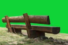 长木凳和绿色屏幕 库存照片
