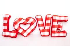 长毛绒红色信件的滑稽的爱词在白色的 免版税库存照片