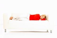 长沙发妇女 免版税图库摄影