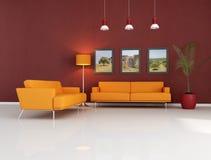 长沙发居住的现代橙色空间 免版税图库摄影