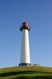 长海滩的灯塔 库存图片