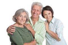 年长父母和他们的成人女儿 免版税库存照片