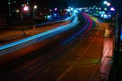 长的曝光线路夜街道 库存图片