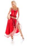 长的红色礼服的少妇 免版税库存照片