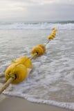 长的黄色浮体和海水 图库摄影