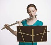长笛女孩使用少年 免版税库存照片