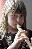 长笛女孩使用的一点 免版税库存图片