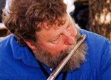 长笛音乐家使用 库存照片