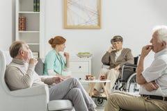 长辈和护士会议 免版税库存照片