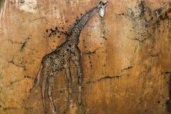 长颈鹿岩石雕刻 库存照片