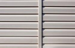 门面的设施镶板米黄乙烯基房屋板壁 库存图片