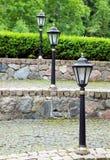 闪亮指示照明设备金属老街道样式 免版税库存图片
